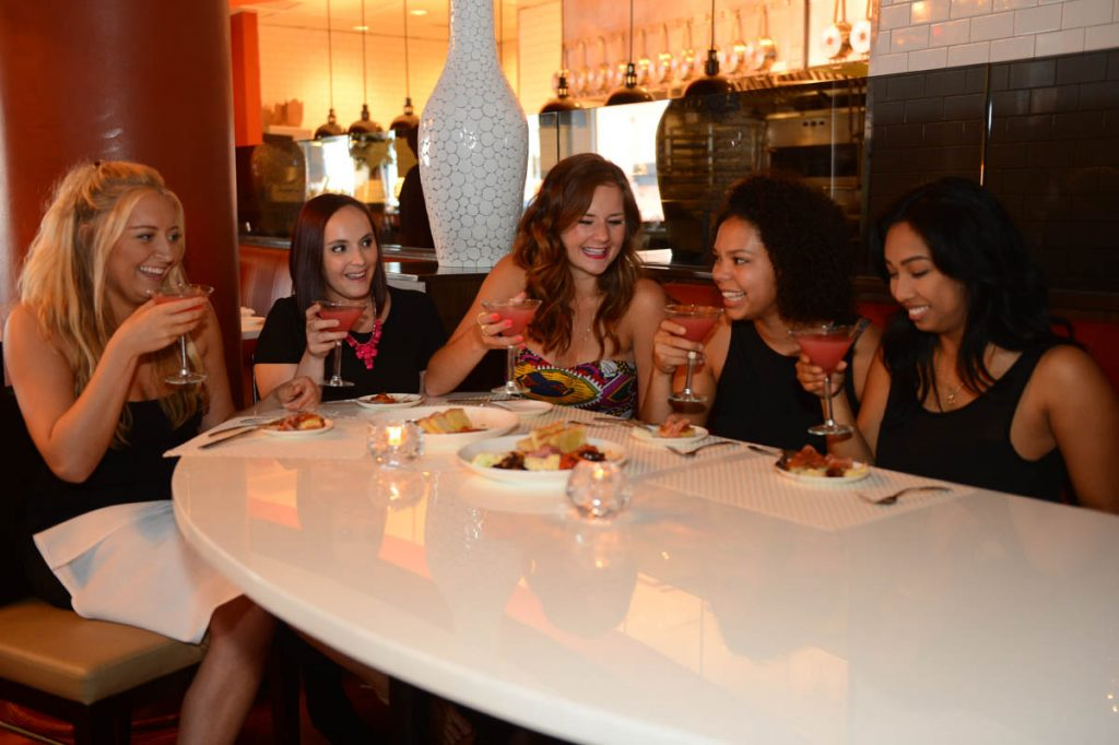 Guests enjoying drinks at Martini Modern Italian