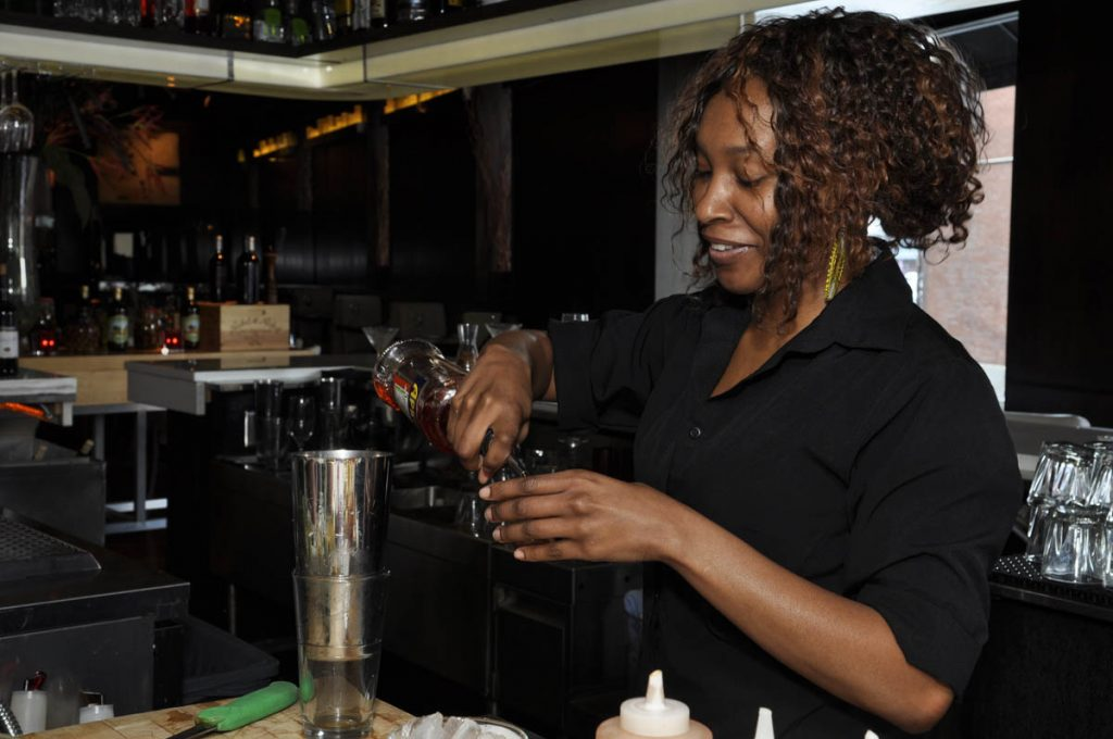 Bartender pouring drinks at Martini Modern Italian