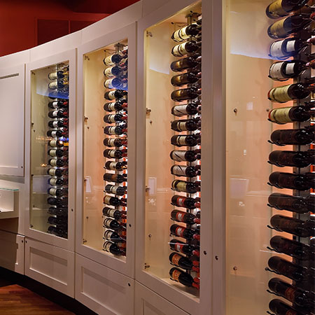 The wine cabinet full of wine bottles inside Martini Modern Italian.